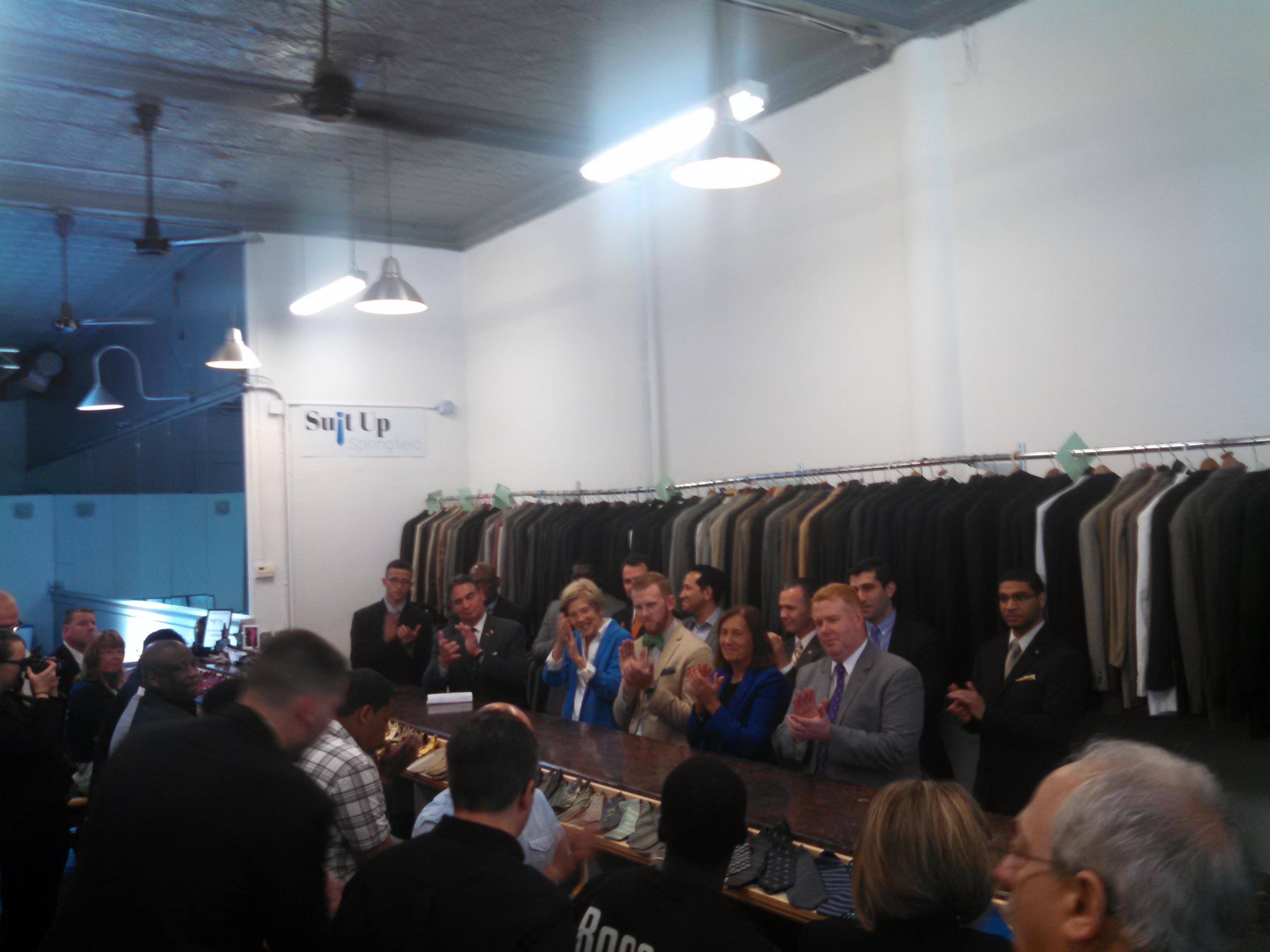 Senator Elizabeth Warren in light blue jacket with Suit Up Springfield's Justin Roberts at her left. (WMassP&I)